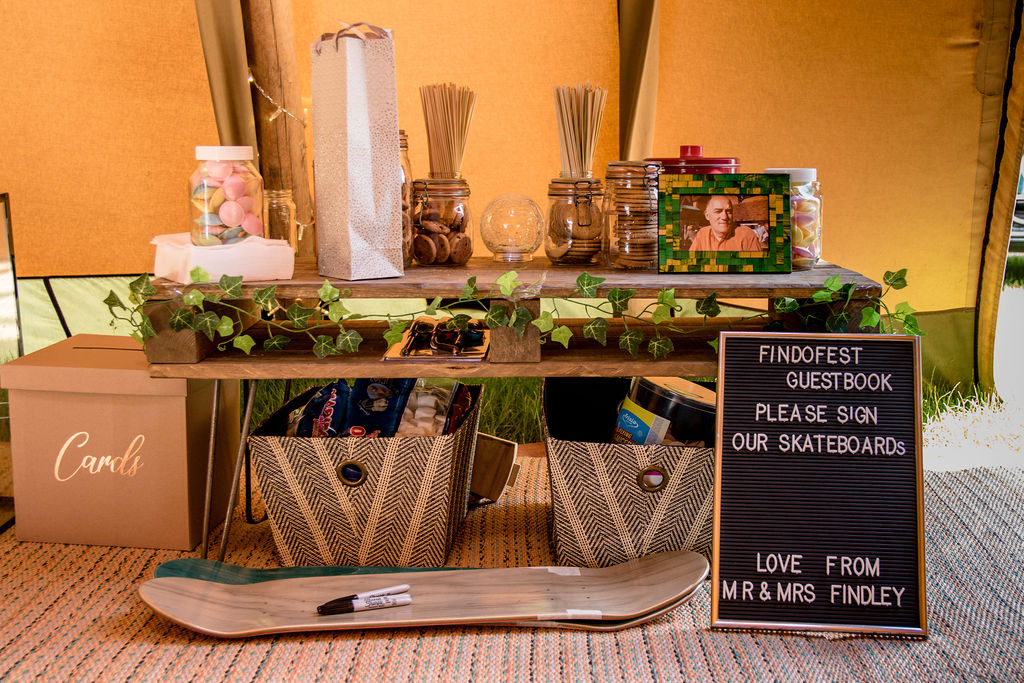 Gift table and Alternative skate board guestbook at tipi wedding
