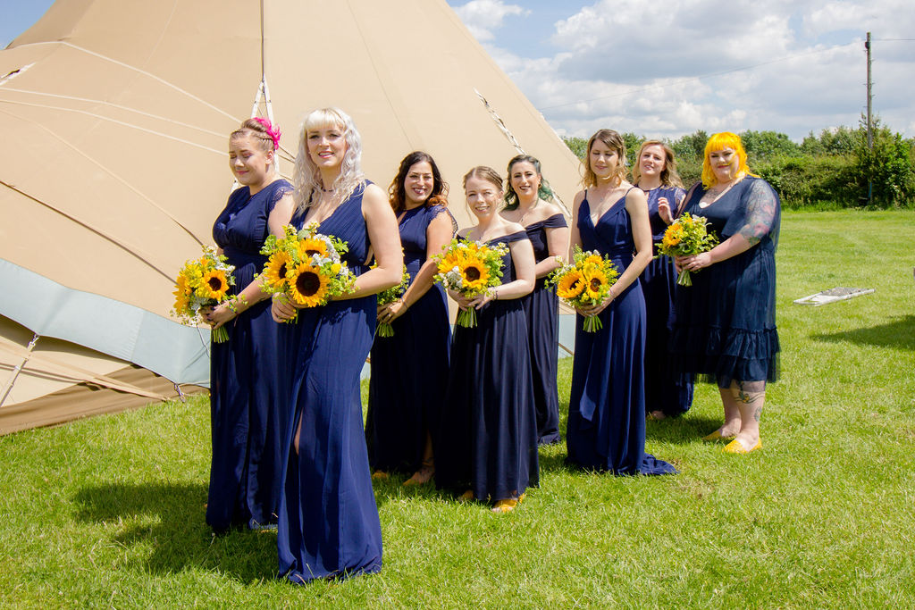 Cattows farm ceremony 8 Bridesmaids wearing Navy with sunflower bouquets