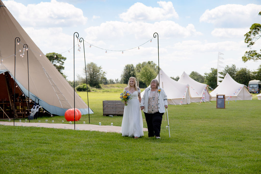 Cattows Farm Wedding with Three Giant Hat Tipis, Bride Walking down Tipi walkway to ceremony