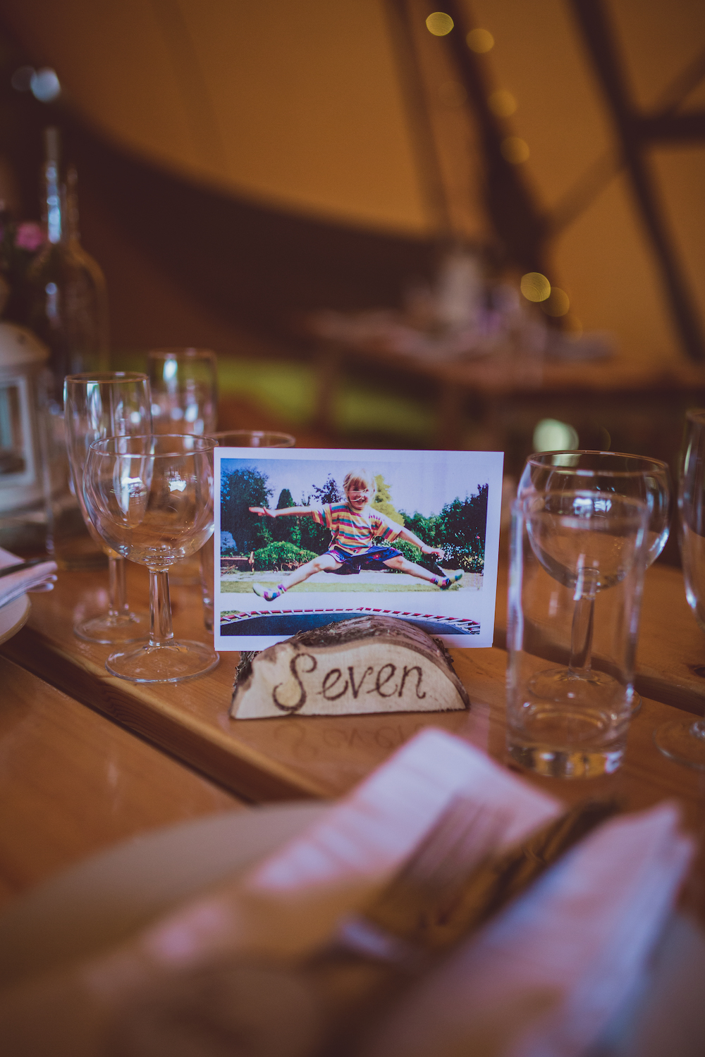 rustic table numbers made of logs