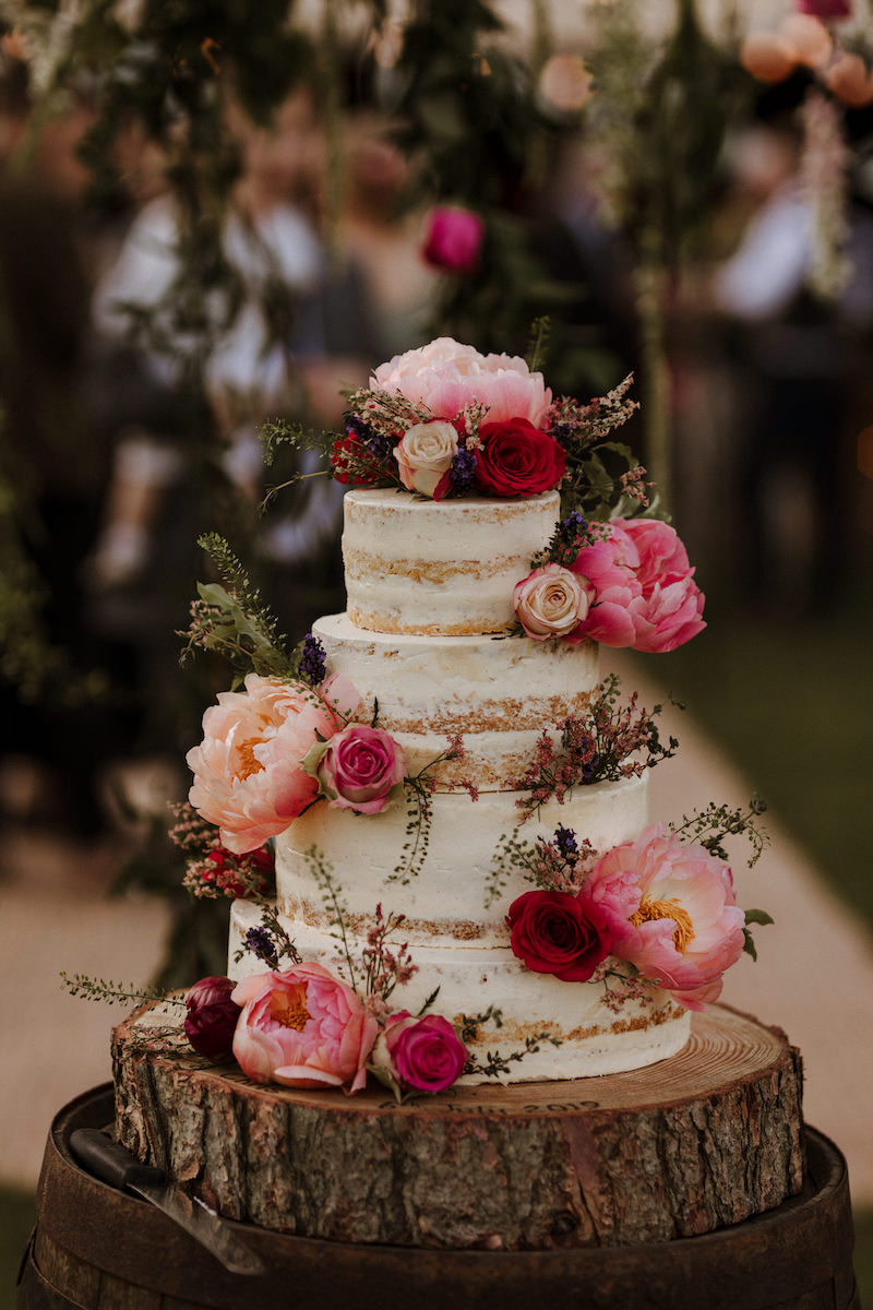 Plant Based vegan wedding cake natural with light frosting and floral decoration