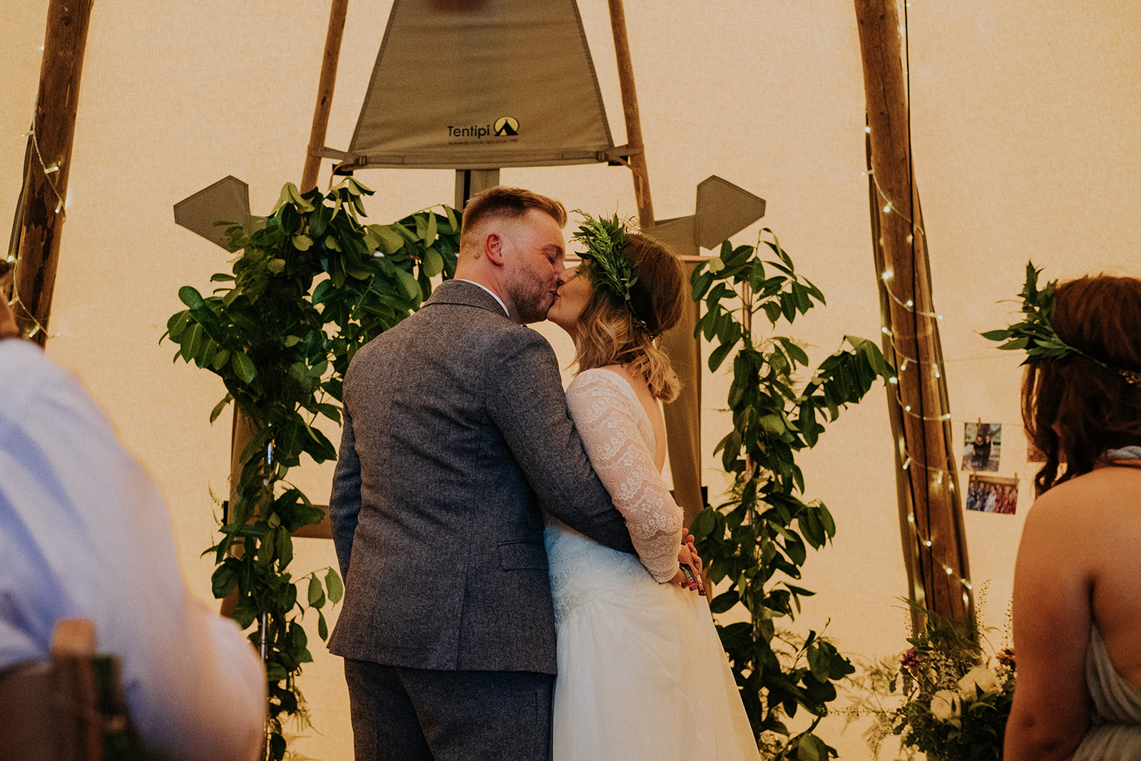 Bride and Grooms first kiss in the tipis after their teepee wedding ceremony at cattows farm wedding
