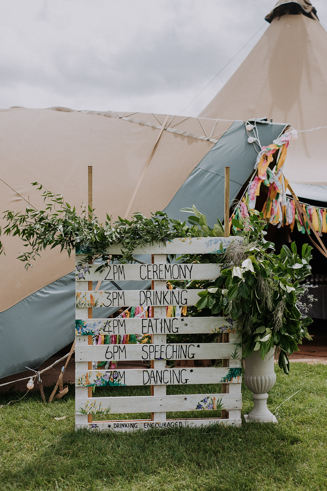 Rustic timeline for the day on pallet cattows farm wedding with sami tipi