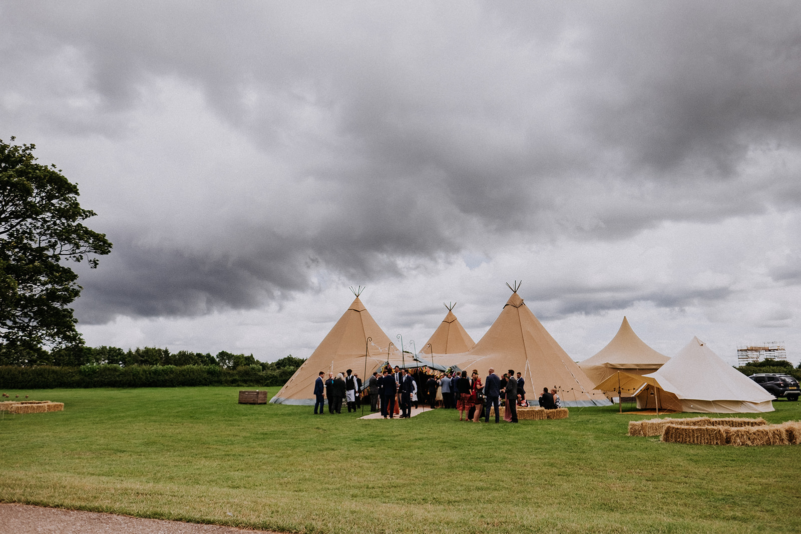Three Giant Hat tipi setup for Cattows Farm Wedding