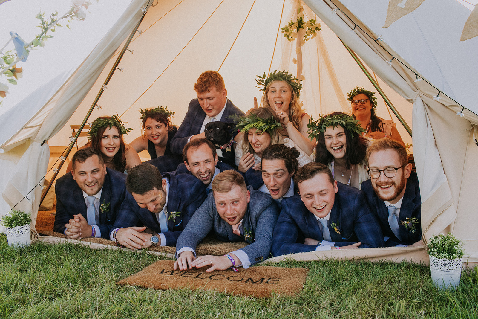 Bridal party crashing the glamping tent cattows farm wedding with sami tipi
