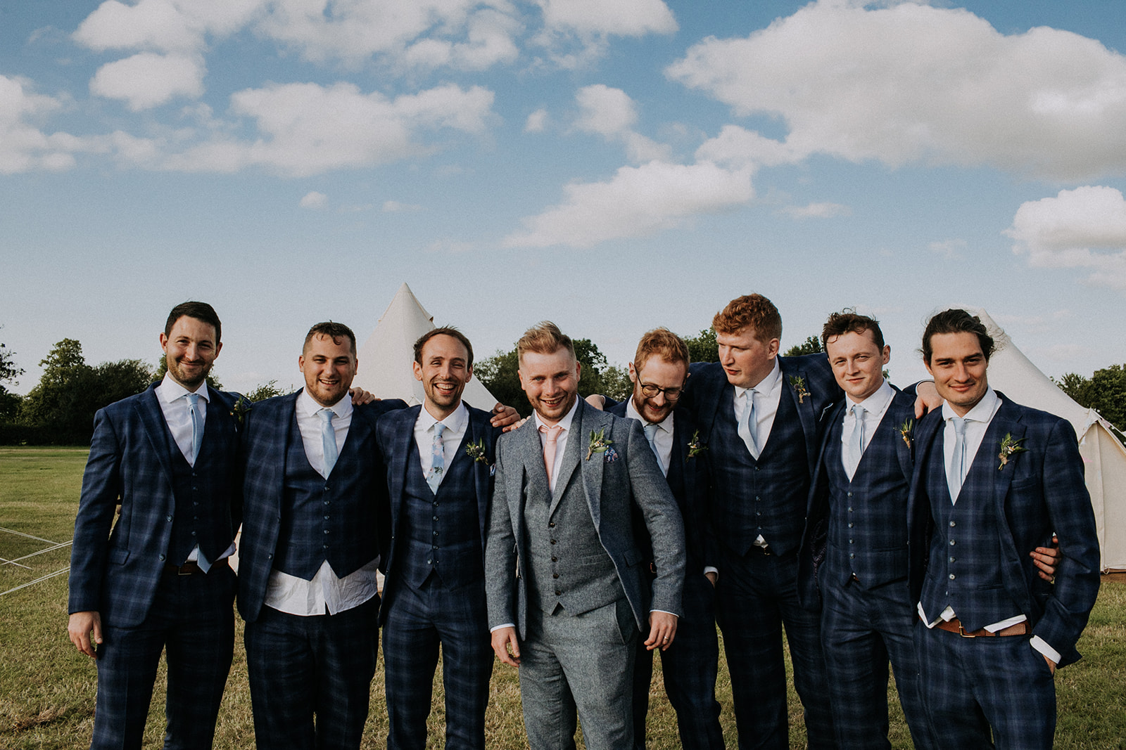 Groom and Groomsmen ready for their cattows farm wedding