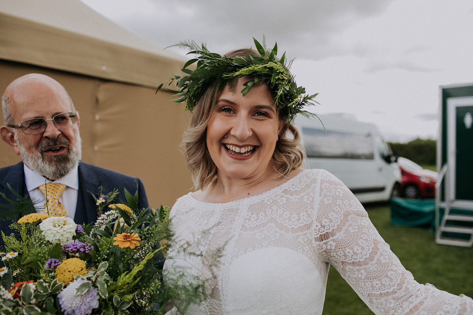 Bride with greenery crown and relaxed bouquet ready for her tipi celebration at cattows farm wedding