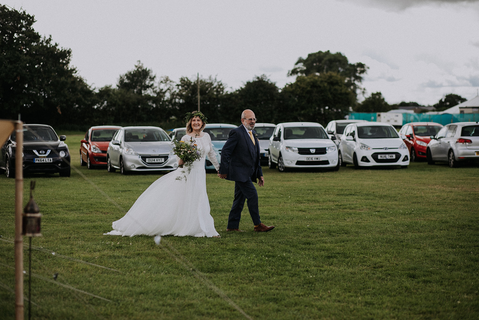 Bride arriving to Cattows Farm wedding ceremony with father
