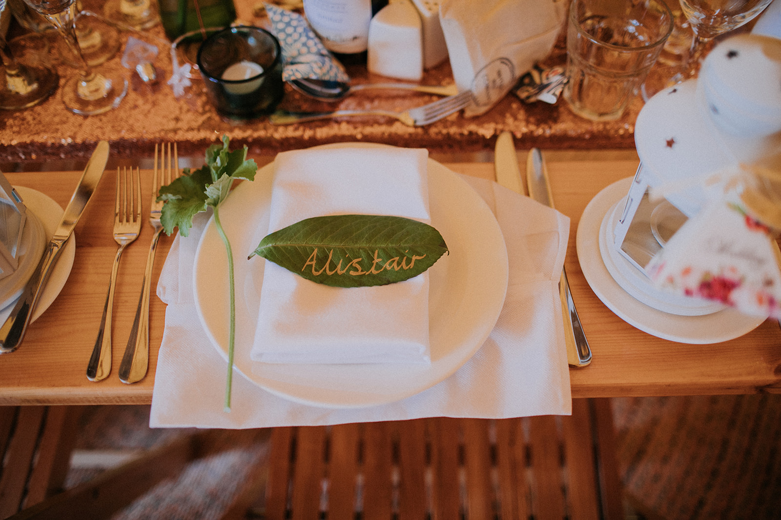 Hand written leaf as place name setting. Cattows Farm wedding with sami tipi