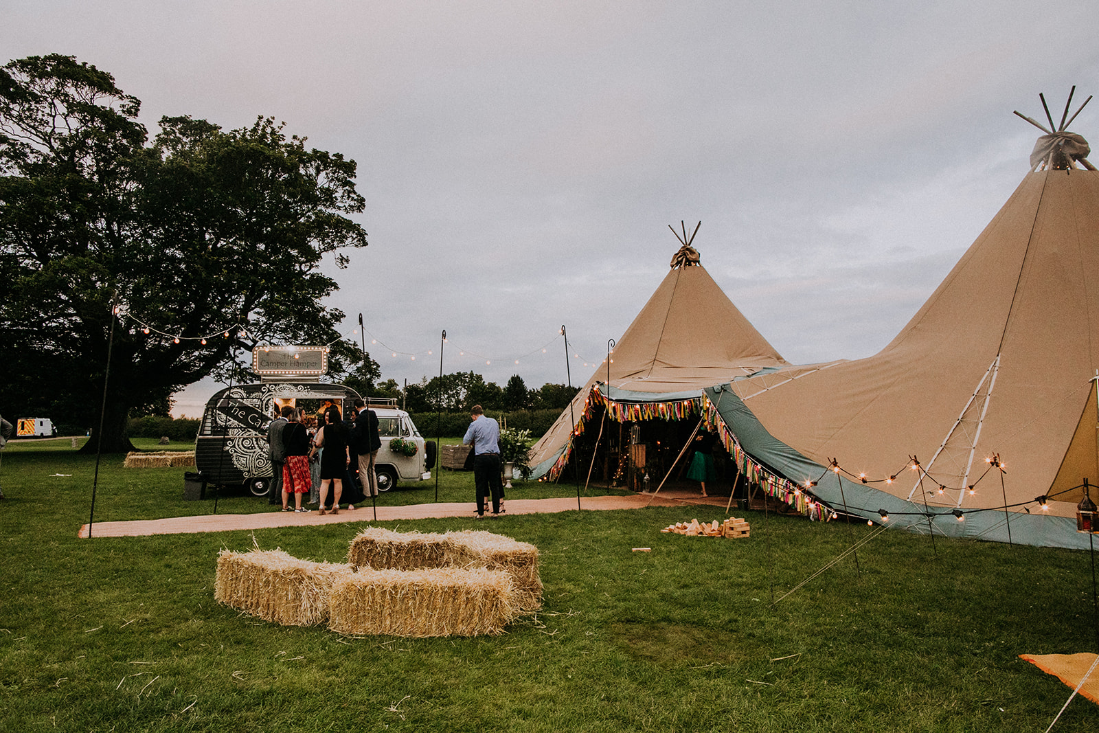 Cattows Farm wedding with Teepees, bales seating and burrito van