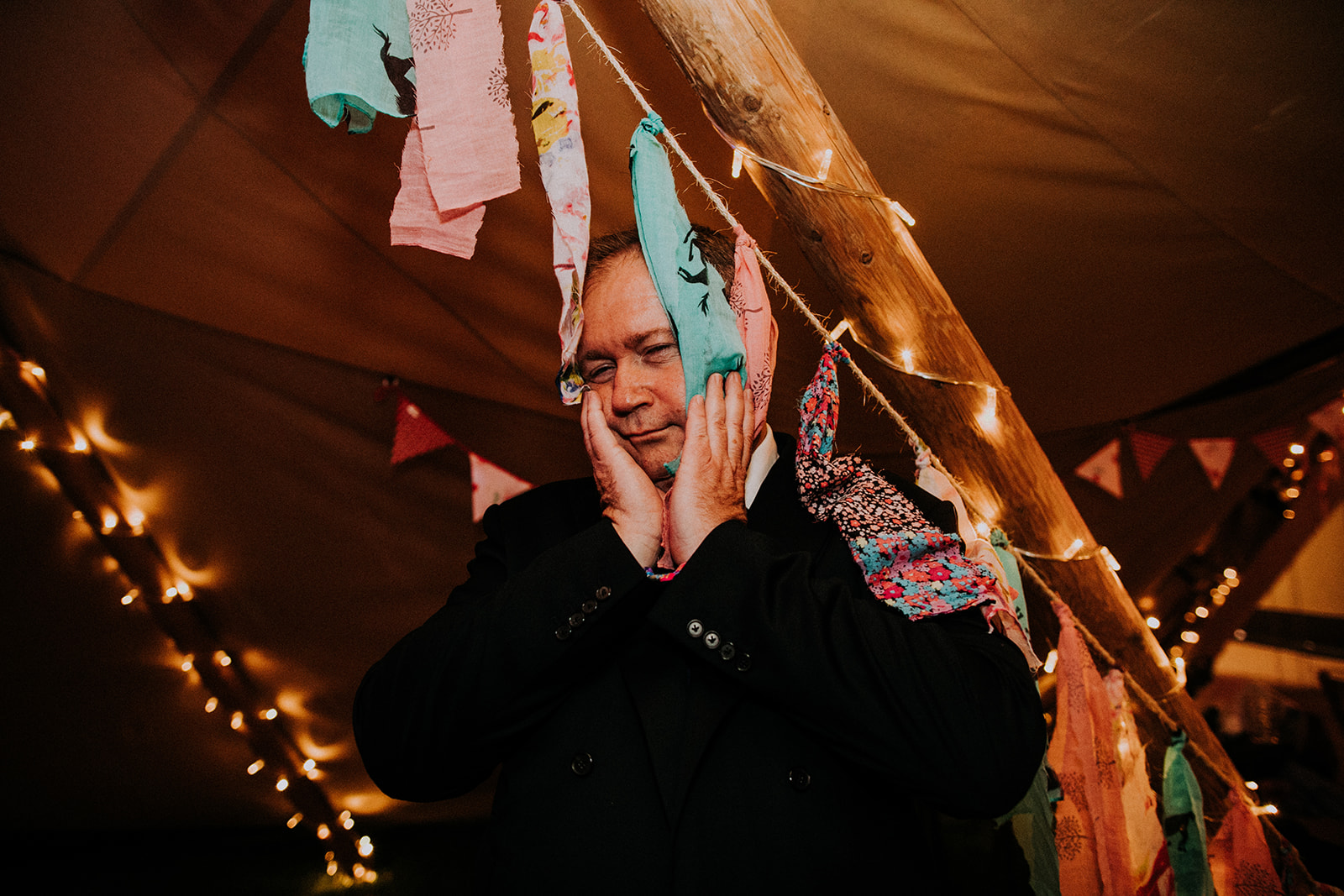 Rag bunting in tipis - cattows farm wedding with sami tipi