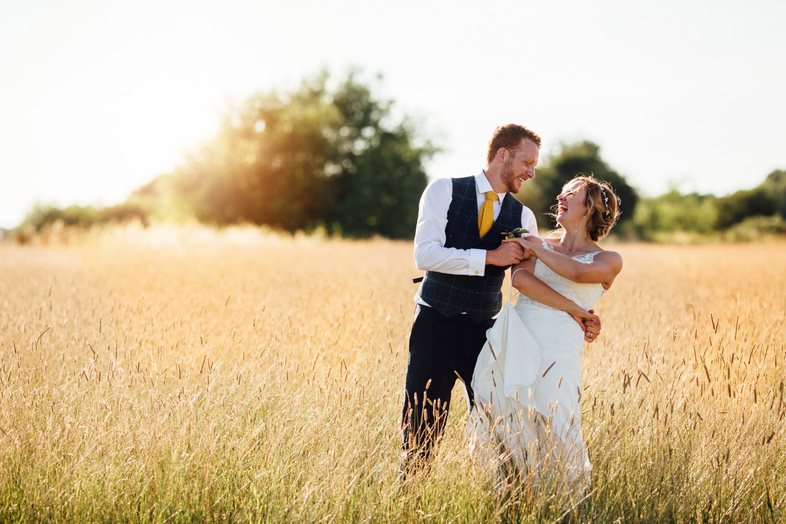 Sunflower filled outdoor wedding celebration at Cuttle Brook. Making the most of the surrounding farmers fields
