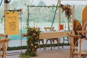 Top Table for two a sweet heart table with trailing flowers for Sailcloth Tent Wedding