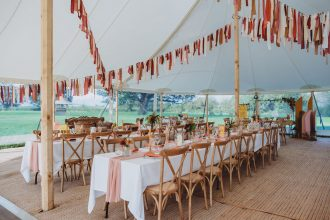 Two Pole Sailcloth Tent internal View with Tables setup and rag bunting hanging