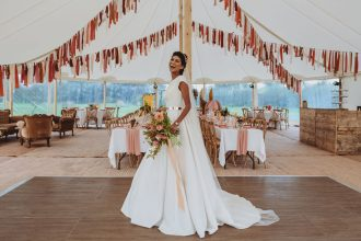 Bride on the dance floor in two pole sailcloth tent