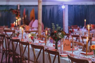 Candle light tables at night for Sailcloth Tent wedding celebration