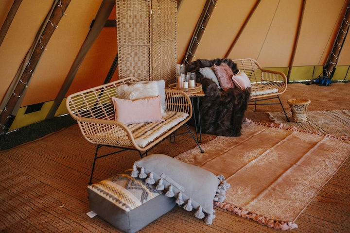 relaxed chill-out zone within giant hat tipi