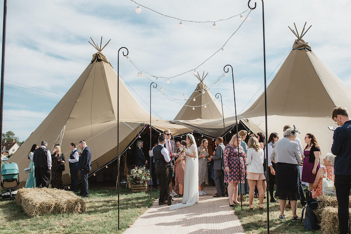 Four giant hat tipi wedding