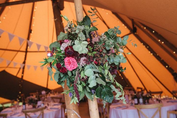 floral decorations on tipi poles