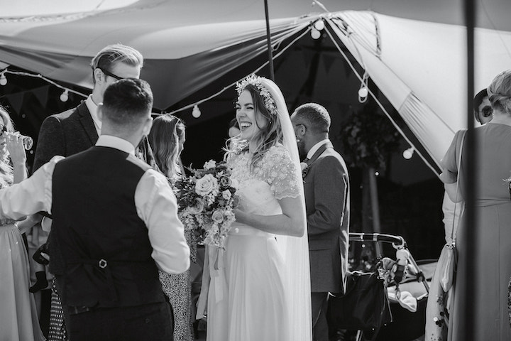 bride and groom mingling with guests at outdoor wedding