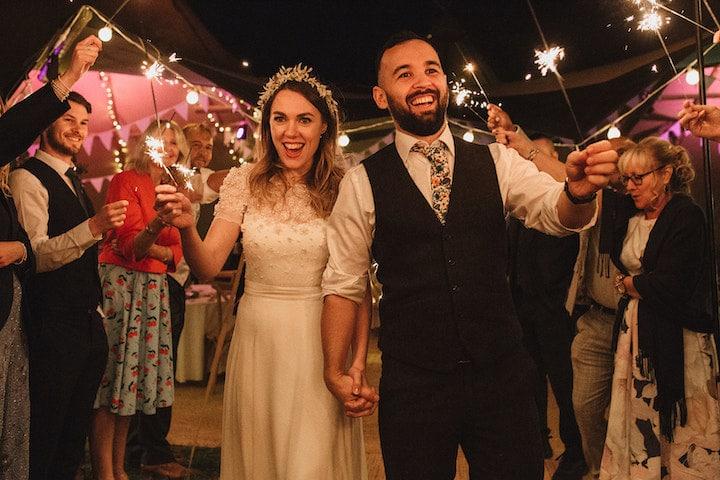 happy couple on the sparkler walkway