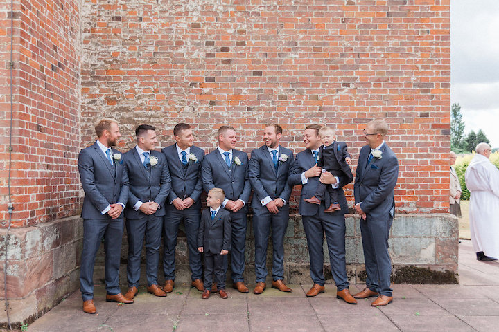 groom and groomsmen waiting at church