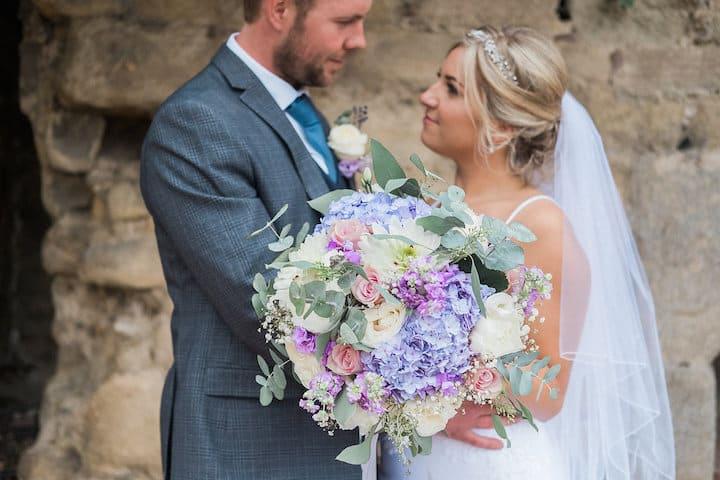 happy couple and bride's bouquet