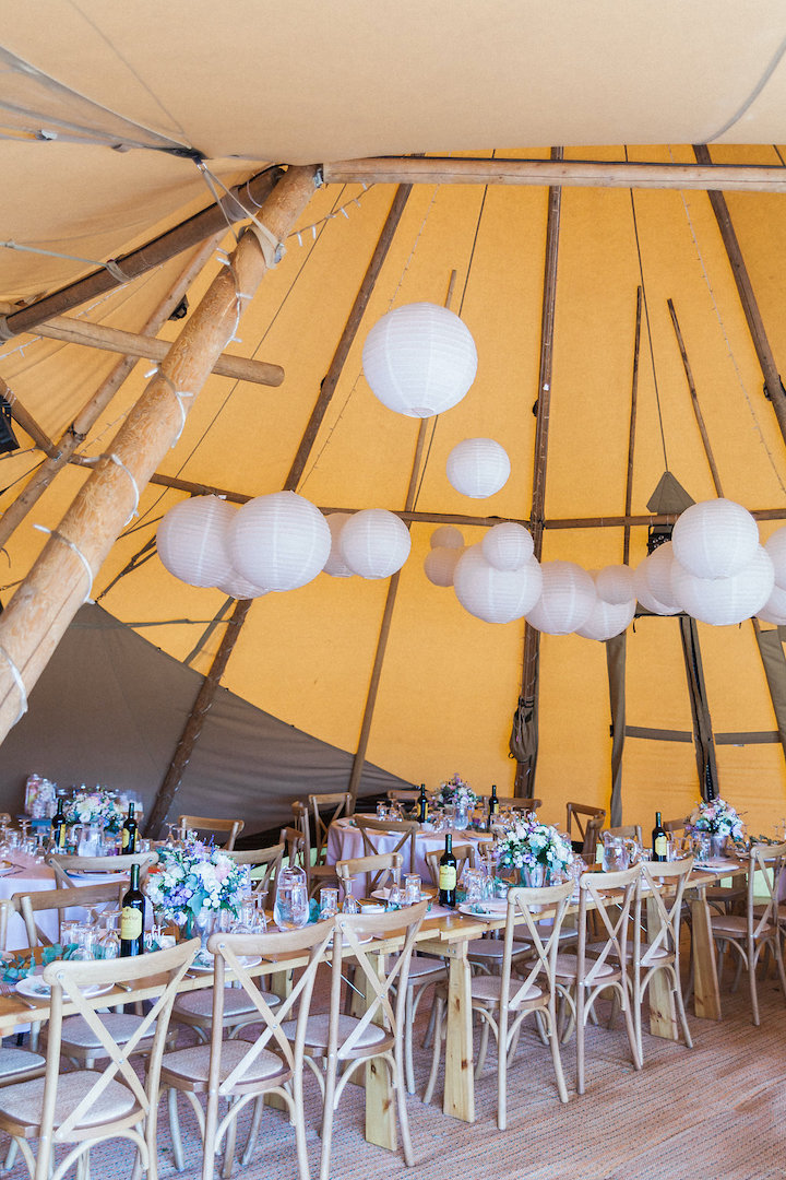 Tipi interior and table layout, with hanging lanterns