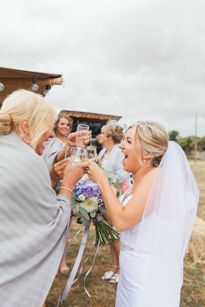 bride enjoying reception with friends and family