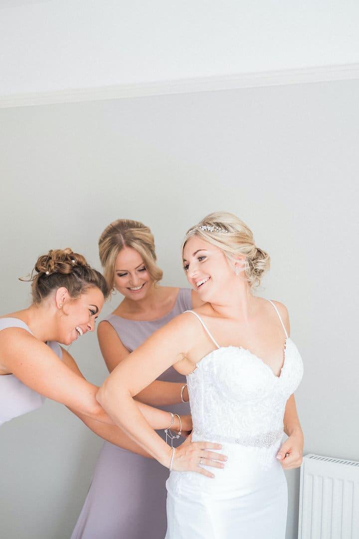 smiley bride getting ready